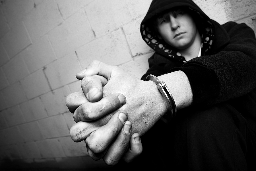 handcuffed teen