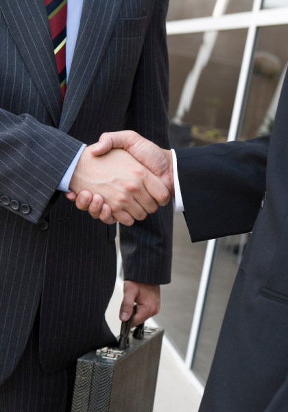defense lawyers shaking hands